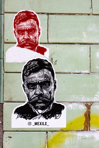 Mexico city posters two portraits on green tile wall-1